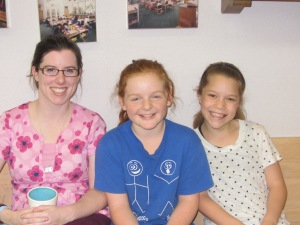 "Nurse  Beaulac, Bridget, and Evelyn-future 5th grade kinder ""buddies"" anxiously wait to welcome our new students ."