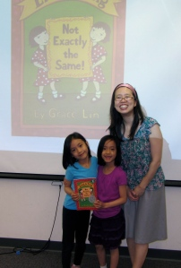 1st grade sisters Sophia and Audrey are elated to pose with Grace with a copy of Ling and Ting.