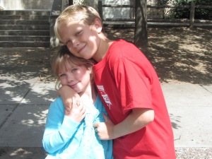 Jacob giving a hug to his sister at recess.