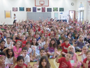 Students wave to Mrs. Hutton at the start of the assembly.